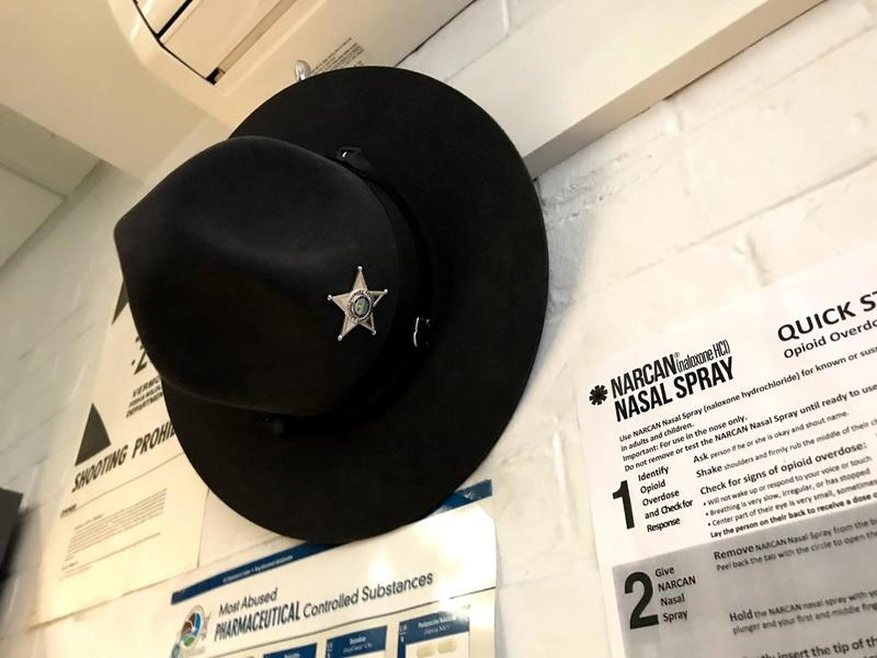 sheriff's hat  hanging on the wall