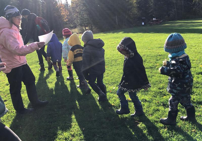 Preschoolers from Coventry march into the woods for their first Forest Day in the NEK activity.