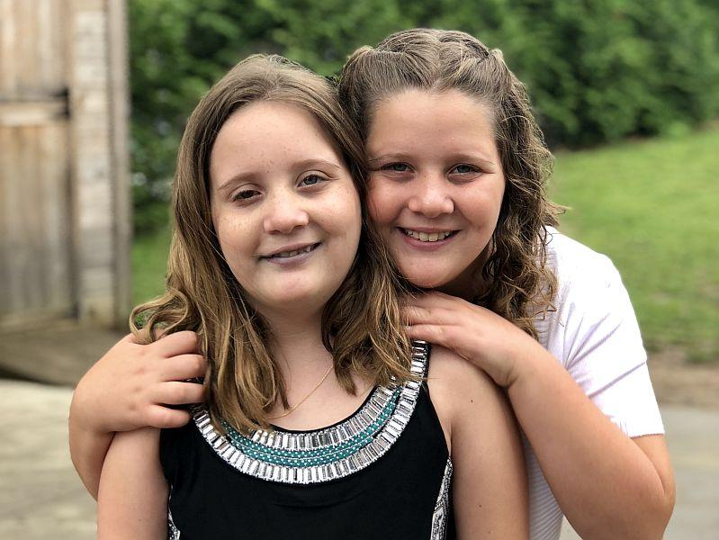 Sophie Posner-Brown (left) was diagnosed with a brain tumor when she was 2 years old. She and her twin sister Isabelle talk about life with a serious illness.