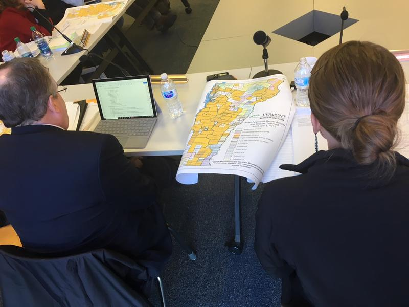 Vermont Education Secretary Dan French, left, and State Board of Education chairwoman Krista Huling consult a merger map during a State Board meeting Wednesday.