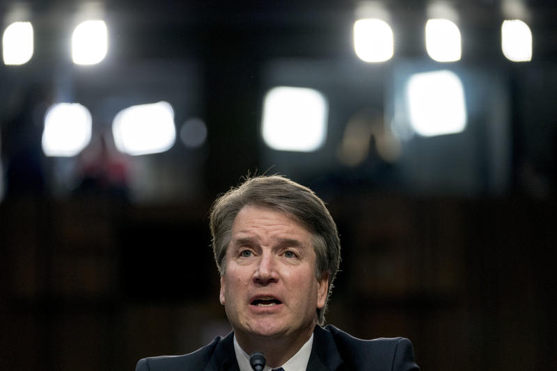 Judge Brett Kavanaugh, pictured here during his confirmation hearing on Sept. 4, with a variety of lights in the background.