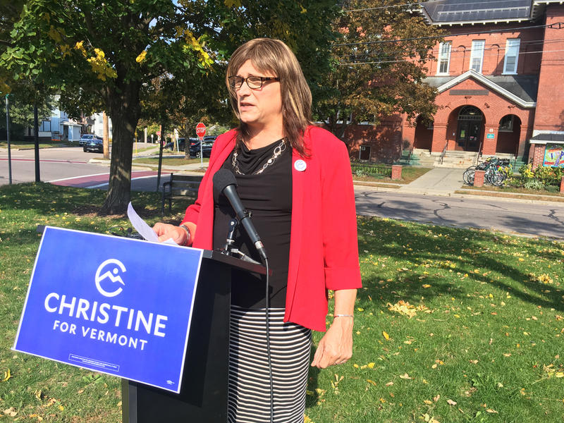 Christine Hallquist, the Democratic candidate for governor, outlines parts of her education platform in Burlington on Wednesday, stading behind a Christine for Vermont sign outside.