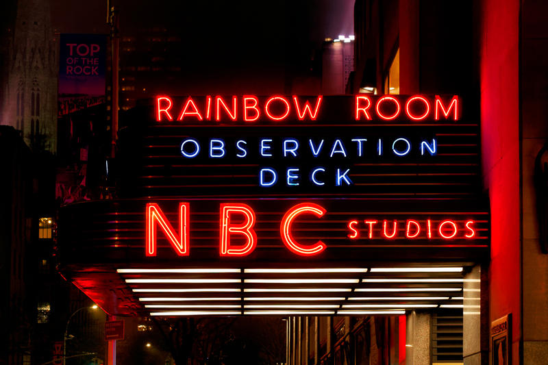 The NBC studios sign at night in Manhattan, that also says Rainbow Room and Observation Deck.
