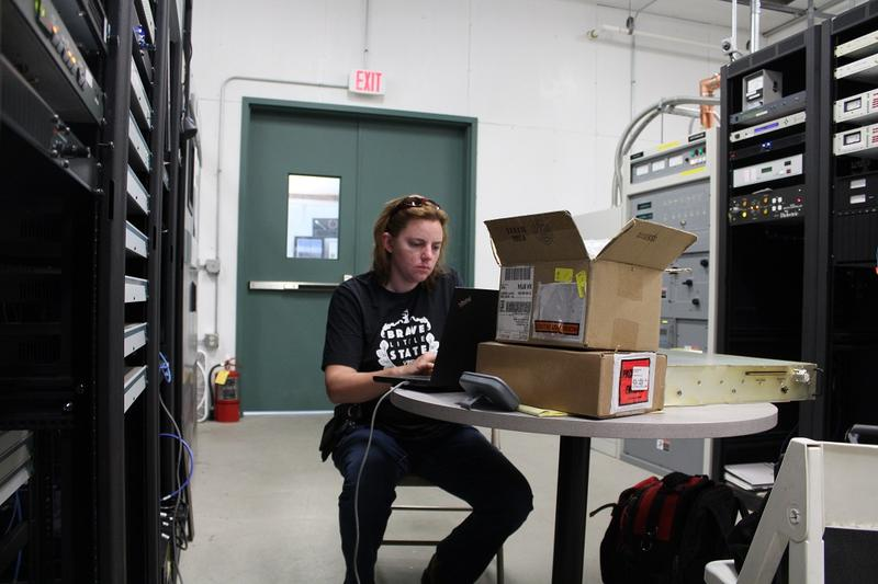 Broadcast engineer Kira Parker prepares to work on equipment at the VPR transmitter room at the Mount Mansfield site.