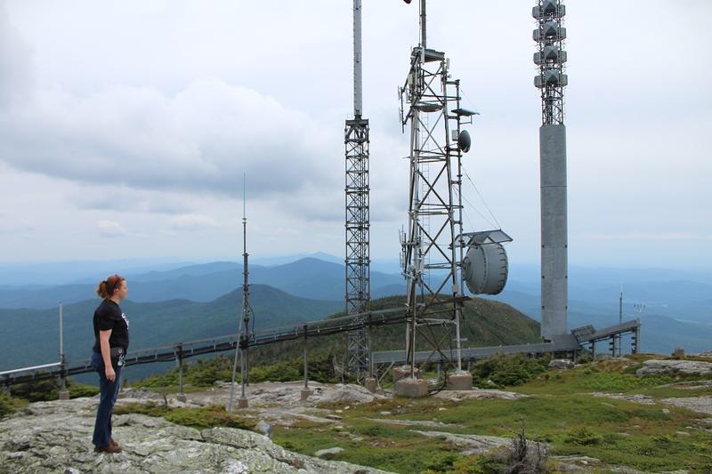 VPR broadcast engineer Kira Parker surveys the top of the Mount Mansfield transmitter site during a June maintenance visit.