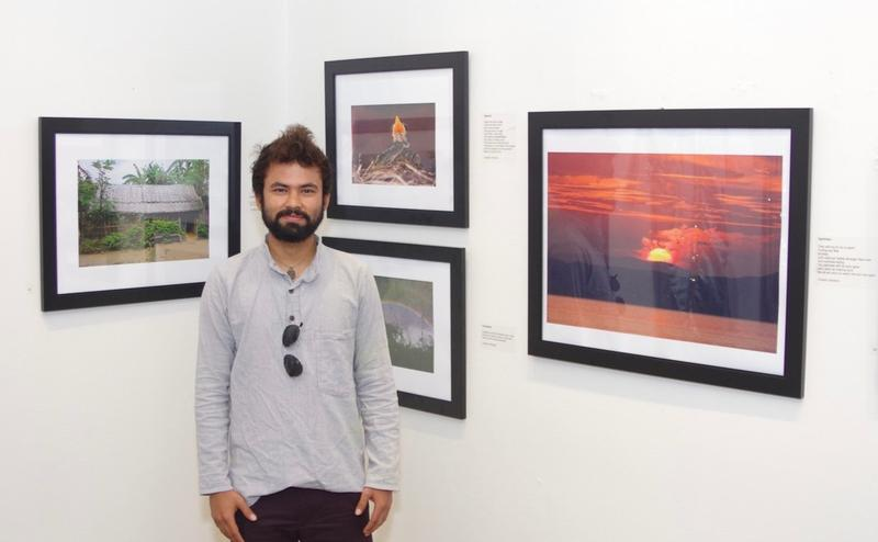 "Umesh Acharya, a Bhutanese refugee now living in Shelburne, shared his photography and poetry in the ""Visions Of The World"" exhibit."