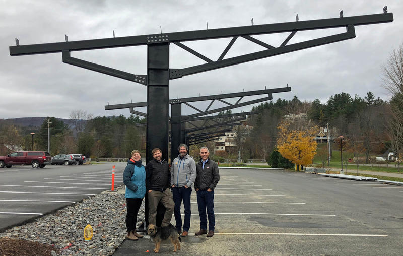From left, The Alchemist owners Jen and John Kimmich, their dog Cookie, SunCommon co-founder James Moore and SunCommon VP of marketing and sales Tom Berry stand under a soon-to-be canopy of 400 solar panels at The Alchemist Brewery and Visitors Center.