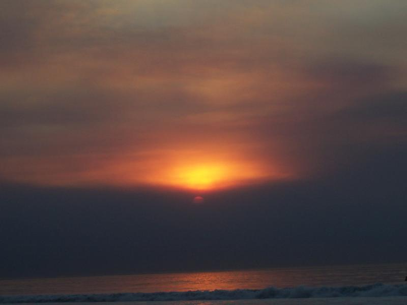 The sky glowed red at midday in San Diego's big fire of 2003.