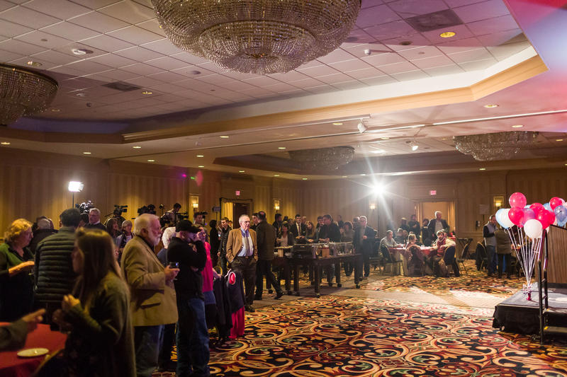A shot of the room where the Republicans' Election Night event was held, with people gathered at tables.