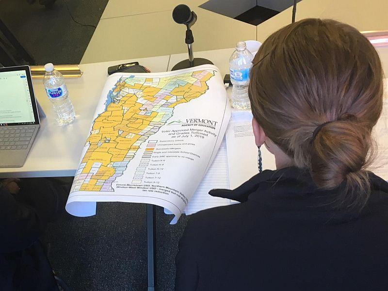State Board of Education Chair Krista Huling looks over a school district map during a recent meeting reviewing Act 46 mergers.