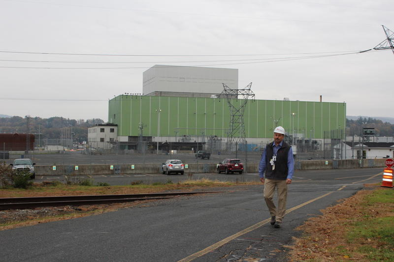 Vermont Yankee Decommissioning Director Corey Daniels walks across the parking lot at the plant.