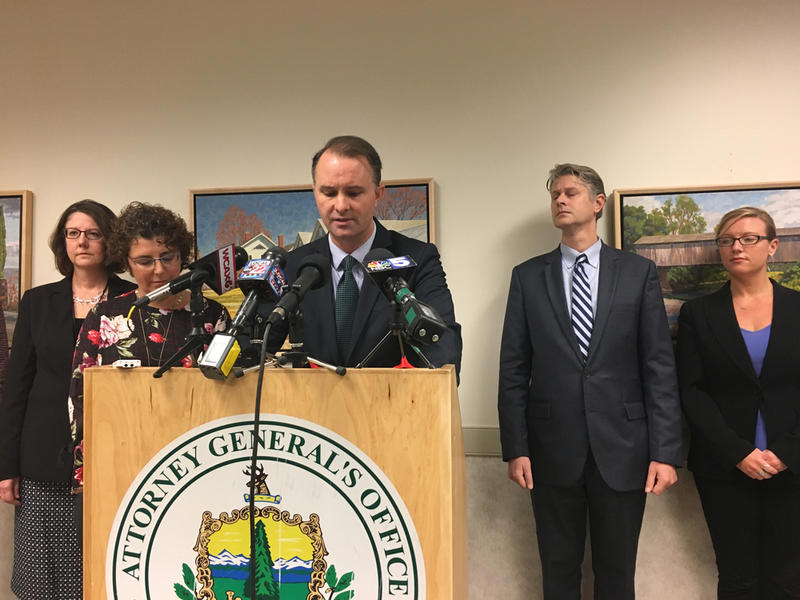 Attorney General TJ Donovan at a podium at a press conference on Friday.