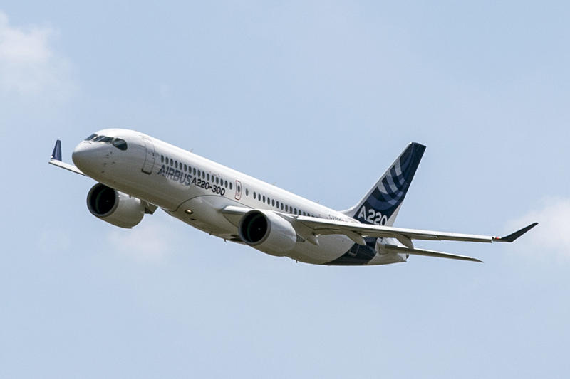 An Airbus A220 flies in the sky in France. The jets were formerly known as the Bombardier C-Series.