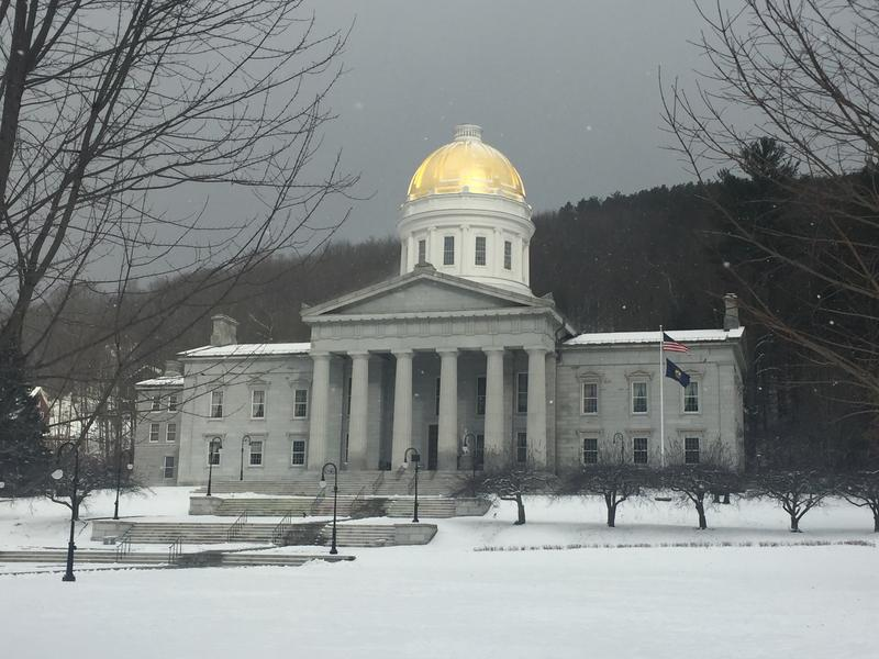 The Statehouse without its Ceres statute on a gray day in November with snow on the ground.