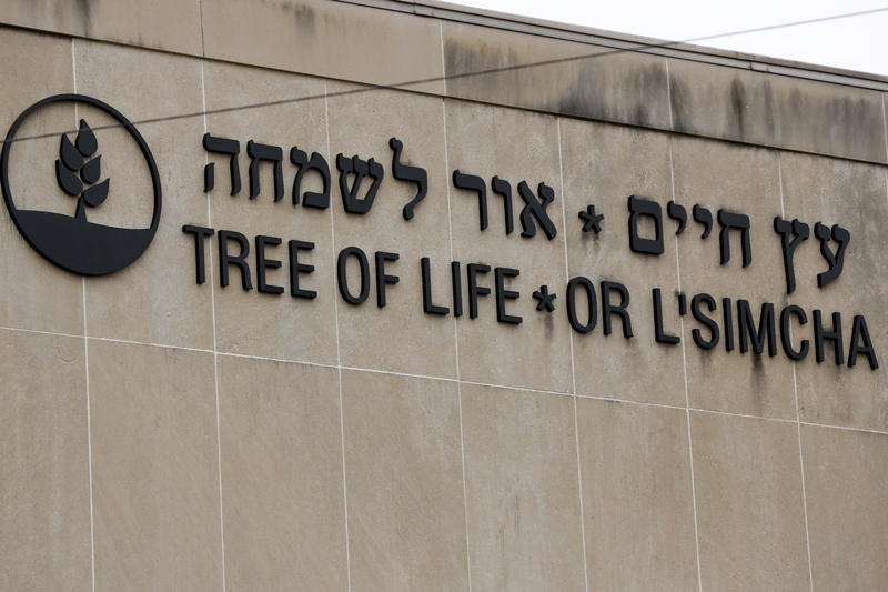 Signs for the Tree of Life Synagogue are shown on the building in Pittsburgh where eleven people were killed and six others injured in a shooting during services.
