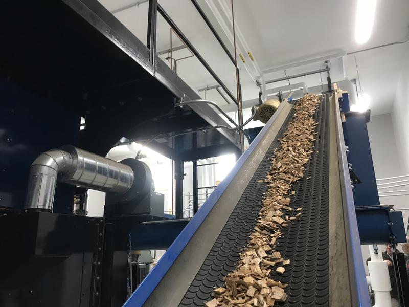Goddard College's new woodchip boiler brings wood chips up from the basement on a conveyer belt.