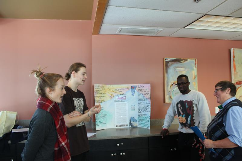 NVU-Johnson students (left to right) Zoe Clark, Tyler Plante, and Tumba Felekeni discuss their research regarding Smugglers' Notch Ski Resort's environmental practices with 'Introduction to Sustainability' course instructor Lisa Zinn.