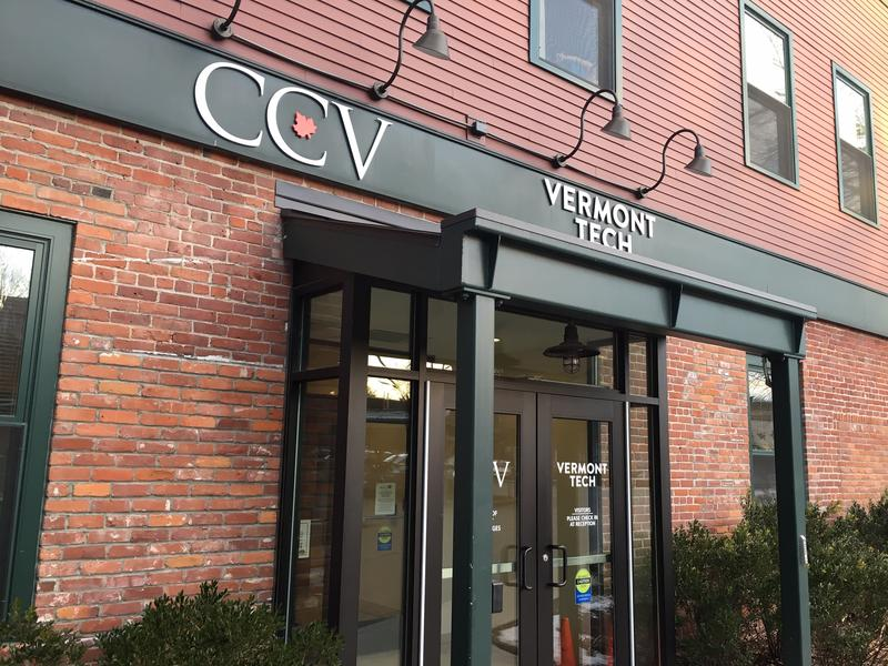 The exterior of the Community College of Vermont, a brick building with CCV sign above door.