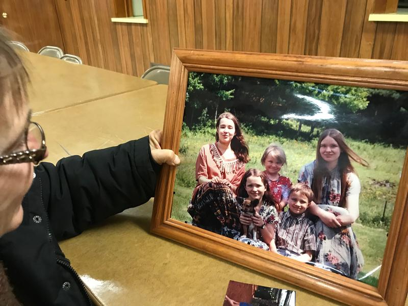 Amy Marcinko holds up a photo of her children. Her daughter Melanie, the youngest, died in March 2018 after an overdose.
