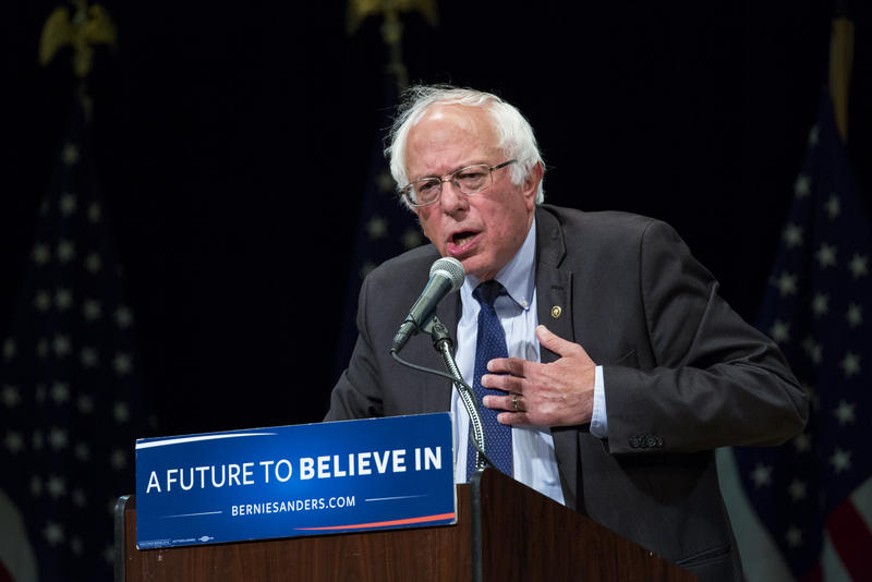 Sen. Bernie Sanders, pictured in June 2016 during his presidential campaign speaking at a podium with the words A Future To Believe In on the front.