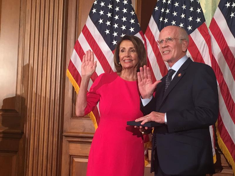 Rep. Peter Welch and House Speaker Nancy Pelosi at Welch's ceremonial swearing in on Capitol Hill on Thursday, Jan. 3, 2019. The two Congress members stand in front of American flags.