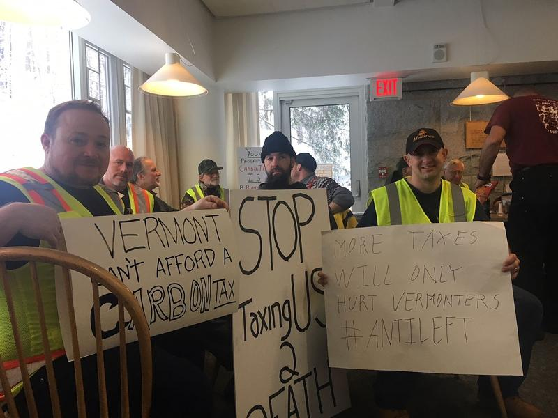 A group of Vermonters, including Justin Sinkevich, at right holding a sign, rallied in Montpelier last week in opposition to a carbon tax. While some lawmakers favor the concept, leadership in the House and Senate are resistant to the idea..