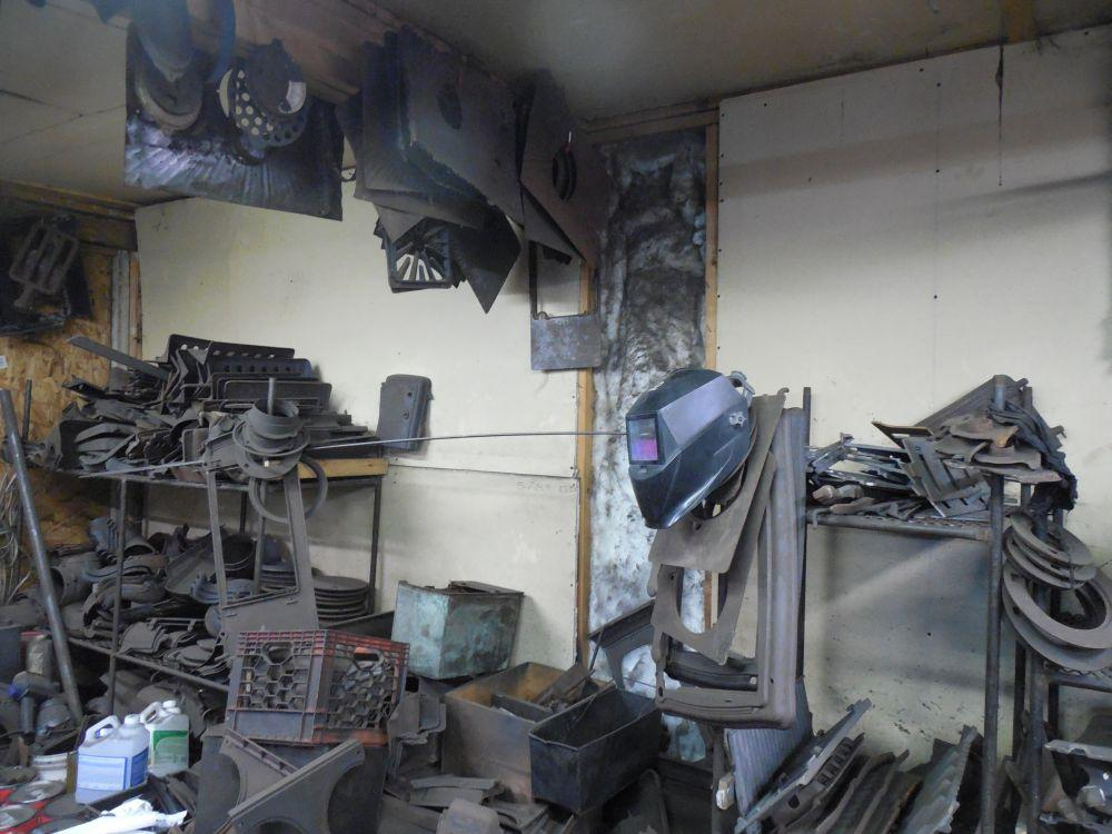Bill Wilber stockpiles parts from stoves to repair those he works on. - Old Wood Cook Stoves Are Still A Draw, For Some Vermont Public Radio