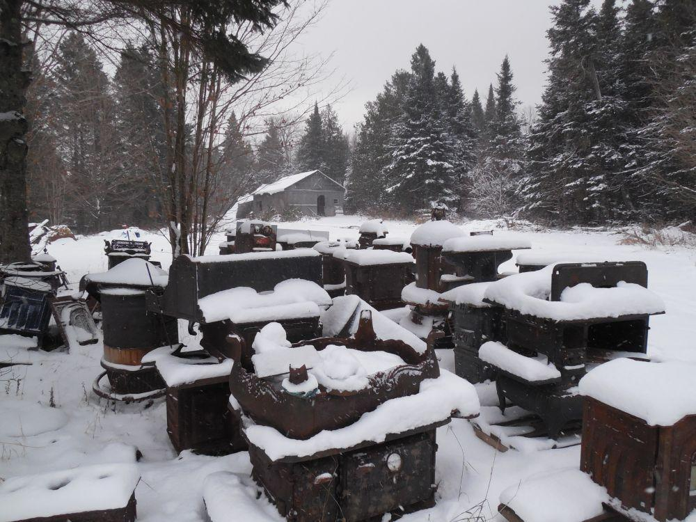 About 300 old stoves hunker in the snow around Wilber's workshop, to be  restored or used for parts. - Old Wood Cook Stoves Are Still A Draw, For Some Vermont Public Radio