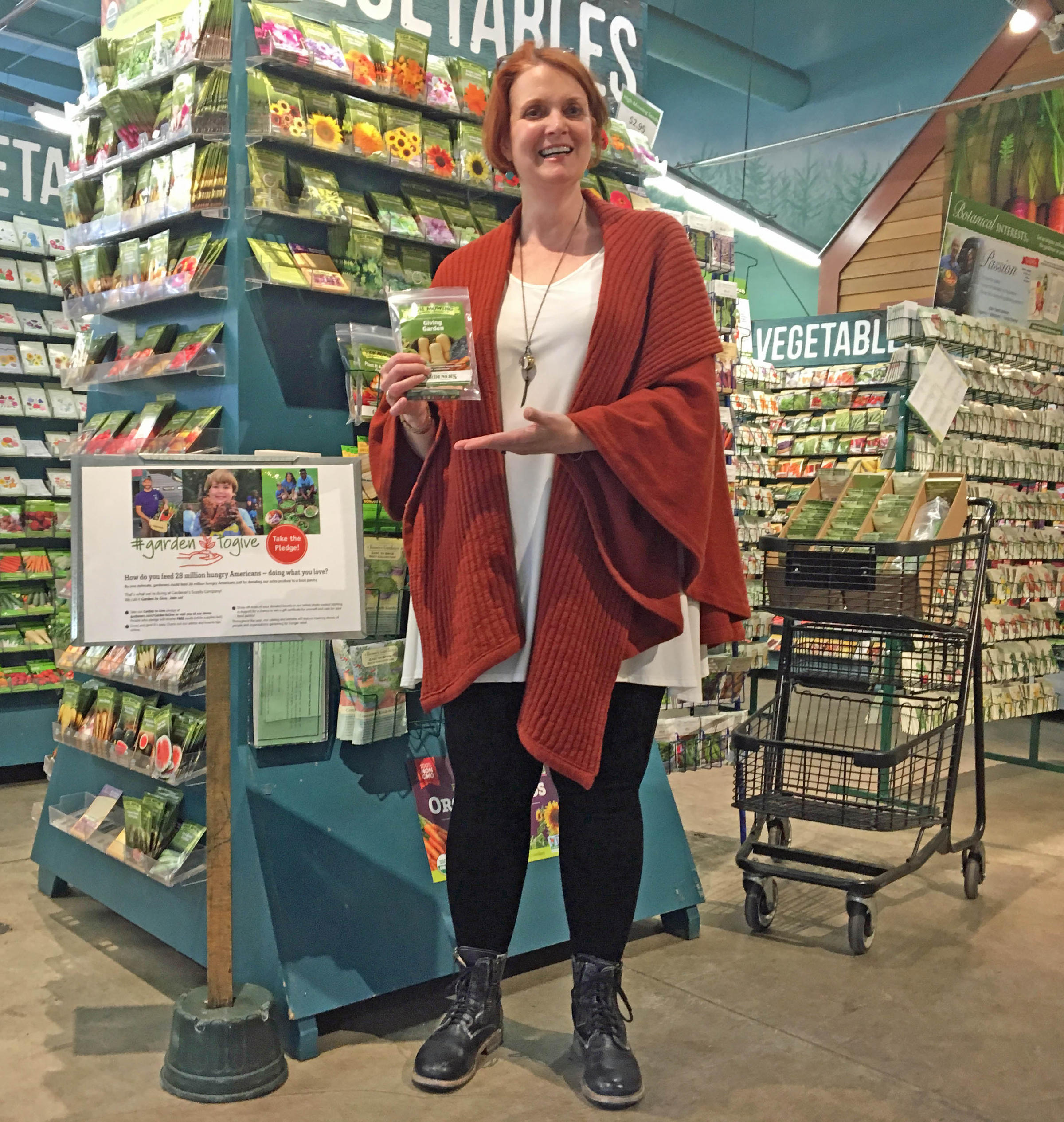 Claudia Marshall Holds A Bundle Of U0027Giving Gardenu0027 Seed Packets From High  Mowing Organic