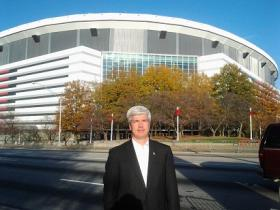 Common Cause Georgia Executive Director William Perry stands in front of the Georgia Dome.