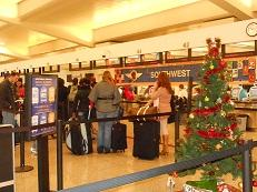 Travelers stand in line on Christmas Eve at Hartsfield-Jackson International Airport