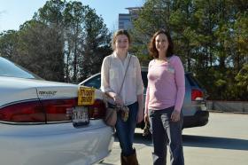 Rebecca Day-Lewis (right) helped Catherine Stephens get behind the wheel after the teenager's brain surgery.