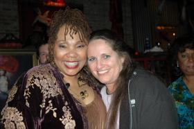 Yolanda King and Maria Saporta at King's 50th birthday party