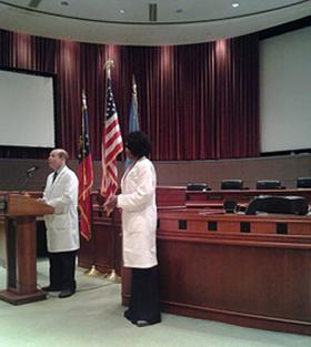 Fulton Co. Health and Wellness medical director Matthew McKenna (l) and Fulton Health Service director Patrice Harris talk about the norovirus.