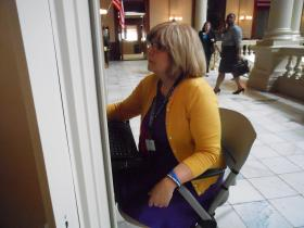 Alice Johnson, director of Georgians for Gun Safety, takes a break from lobbying lawmakers to do a computer check on the status of legislation at the State Capitol, March 20, 2013.