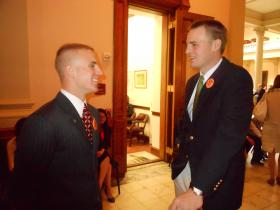 Hunter Hurst (left) and Luke Crawford of Kennesaw State Students for Concealed Carry wait to speak with lawmakers outside the Senate Chamber at the State Capitol, March 20, 2013.