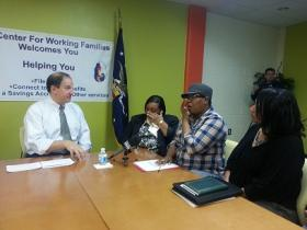 Acting U.S. Labor Secretary Seth Harris sits down with workers at the Center for Working Families in Atlanta.
