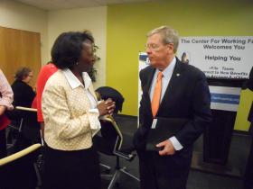 Sen. Johnny Isakson (R-Georgia) talks with Sandy Johnson, Development Director of Dress for Success, at an event supporting the state's Free File program for low-income taxpayers, April 8, 2013, at the Dunbar Community Center.