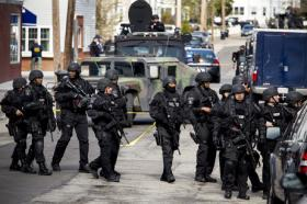 heavily armed police patrol Watertown, MA, in search of the second suspect in the Boston Marathon bombings.