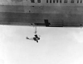 "Airships were often used as aircraft carriers.  From Airliners.net: ""N2Y-1 training plane beneath trapeze and T-shaped opening of Akron's hangar deck."""