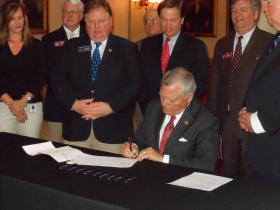 Gov. Nathan Deal signs new state ethics legislation at the Capitol on Monday.