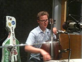 Ben Sollee performing in the WABE studios