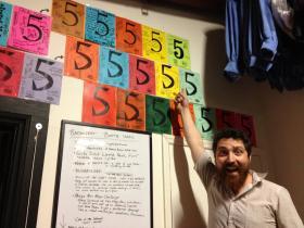 Dad's Garage Artistic Director Kevin Gillese gets a high five