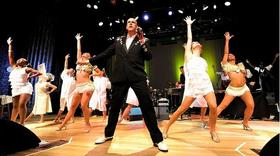 Big Mike Geier fronting the Kingsized Rock 'n' Roll Orchestra, along with the Dames Aflame dancers