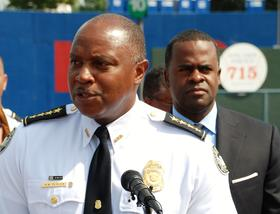 APD Chief George Turner introduces the police department's new cars as Mayor Kasim Reed looks on.