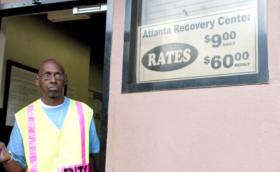 The Atlanta Recovery Center sustains itself on the $9/night residents pay.  Security guard Dwain Smallwood makes sure things stay calm.