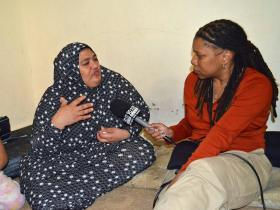 WABE's Rose Scott interviewing a Syrian refugee in Amman, Jordan