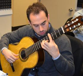 Adam Levin performing in the WABE studios