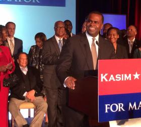 Mayor Kasim Reed delivers his victory speech as former mayor and Reed mentor Andrew Young sits and looks on.