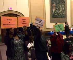 Protesters at Wednesday's community benefits meeting.